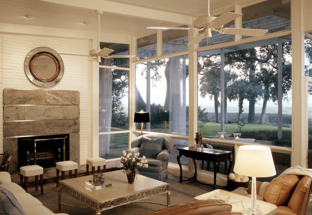Living room with with glass walls overlooking marsh