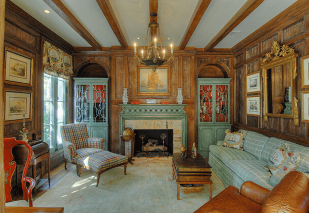 luxury den with fireplace and wood beam ceilings