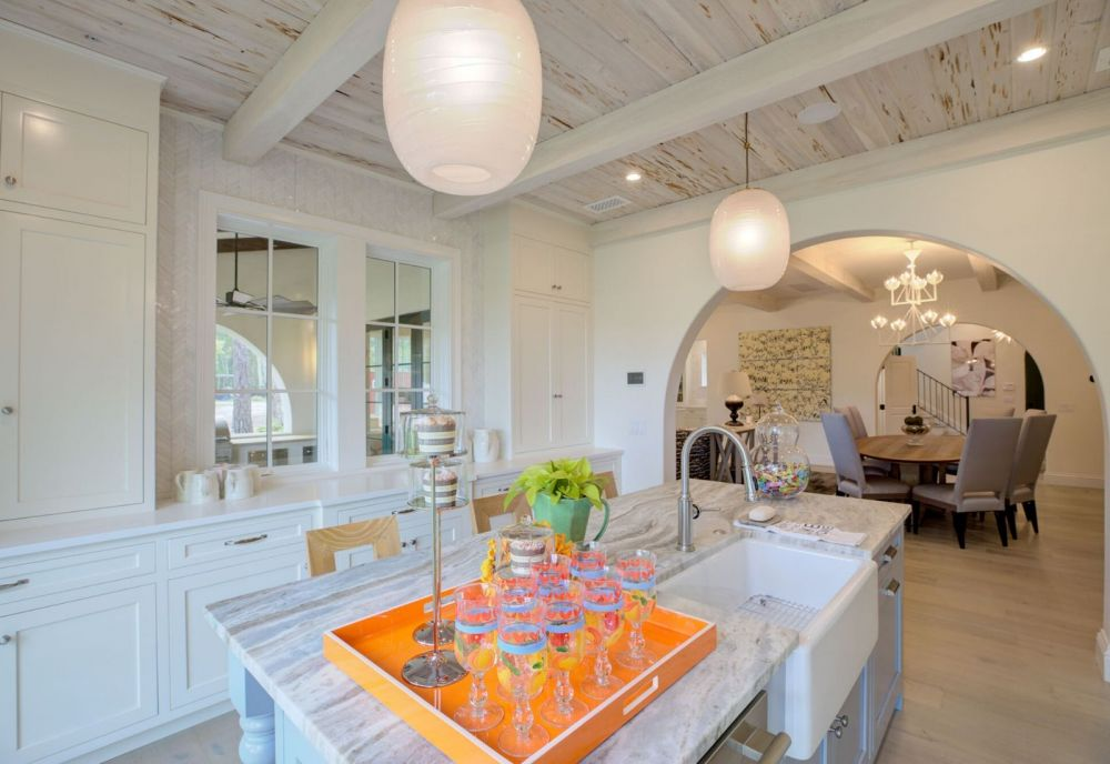 Custom kitchen with arches by Ramsey McHale