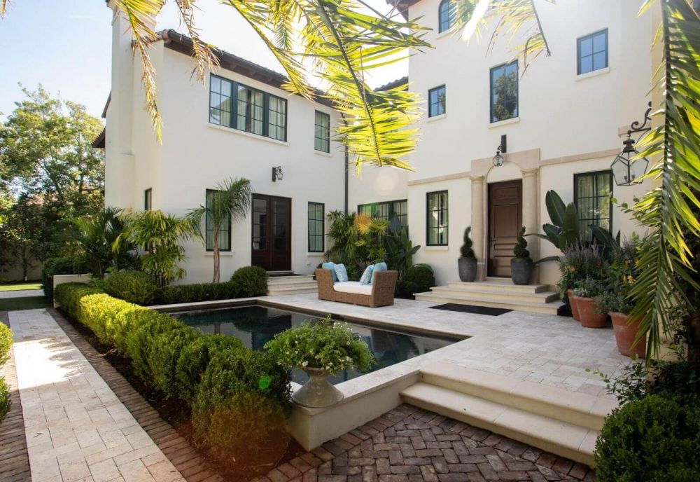 Exterior high end home with pool Sea Island